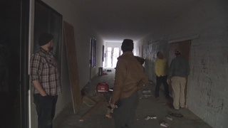 Crews board up business taken over by squatters