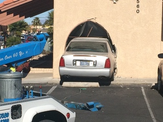 Several injured after car drives into business