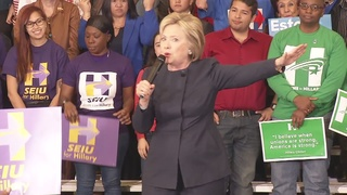 Clinton says she can push US forward at rally