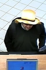 Police search for garden hat bank robber