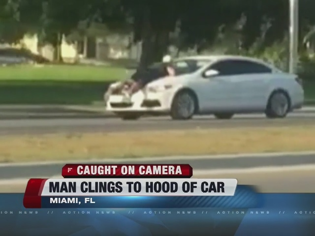 NOW TRENDING: Man clings to hood of car during road rage incident