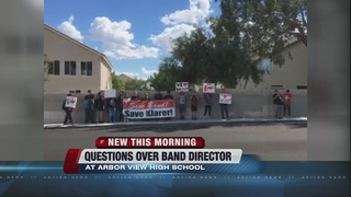 Students fight to keep band director