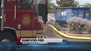 Dumpster fire sends black smoke into air