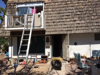 Woman rescued from balcony in Saturday fire