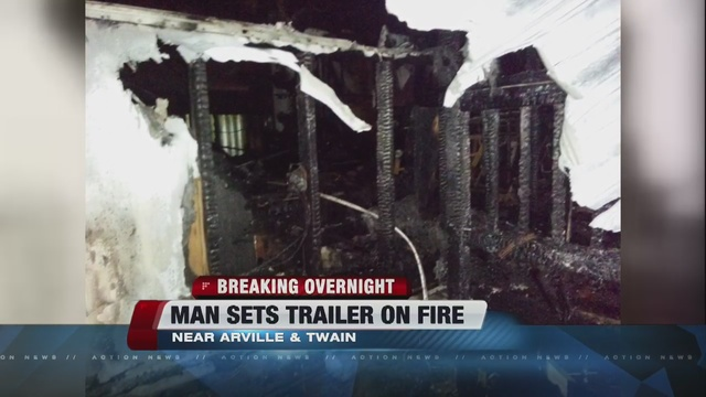 Man sets his own trailer on fire