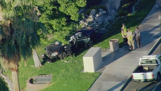Car crashes into wall near Cheyenne and Rampart