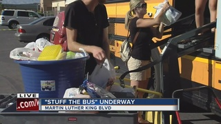 Stuff the Bus event underway at Walker Furniture