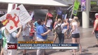 Bernie Sanders supporters march on Fremont St.