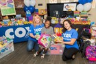 Cox donates thousands of school supplies