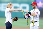 Bryce Harper holds Katie Ledecky's many medals