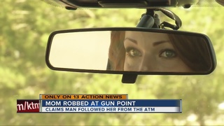 Henderson mom: robber pointed gun at baby