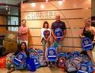 Colliers donates backpacks to Tanaka Elementary