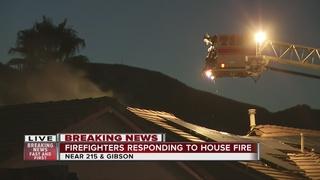 Firefighters battle house fire in Henderson