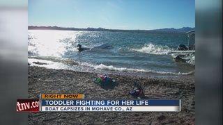 Toddler fighting for life after boat capsizes