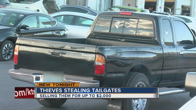 Thieves stealing pickup truck tailgates