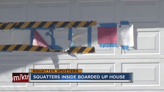 SQUATTERS: Squatters inside boarded up home