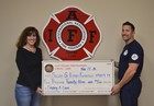 Firefighters donate money to cancer nonprofit