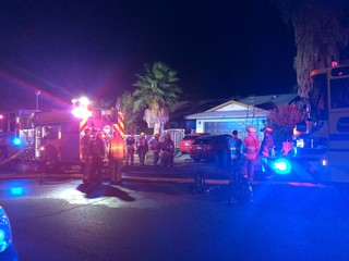 Man rescued in Reno Ave. house fire