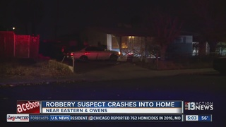 Robbery suspect crashes into home