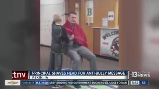 Iowa principal shaves head to send message