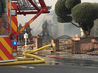 Firefighters escape before roof collapses