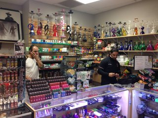 Smoke shop owner stands up to armed thief