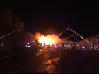 Fire crews fight huge flames across from Rio