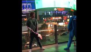 WATCH: Eeyore and musician fight on Vegas Strip