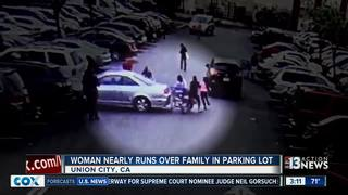 Video shows woman ramming people in parking lot