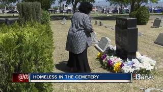 Woman helps homeless sleeping on headstones