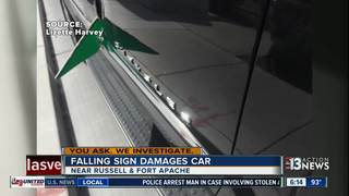 Family says sign slashed through car door