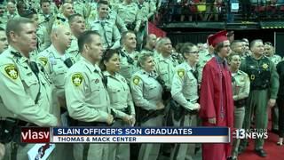 Slain police officer's son graduates high school