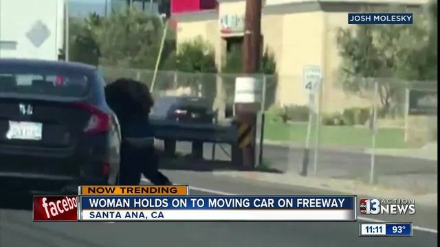 Video shows woman clinging to car on California freeway