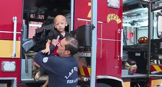 Las Vegas firefighters stand by boy with cancer