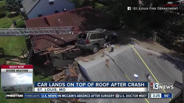 SUV lands on roof of house in Saint Louis