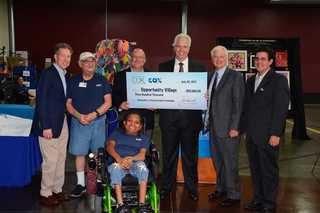 Cox presents check to Opportunity Village