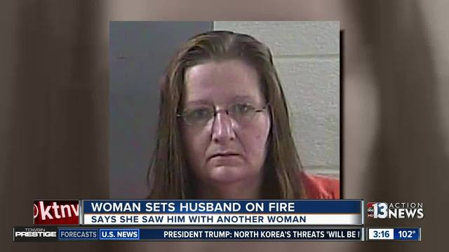 Woman arrested after allegedly setting husband on fire