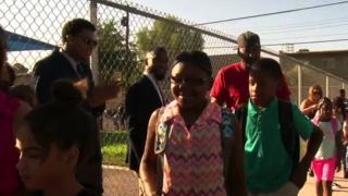 100 men to greet students on first day of school