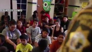 Vegas officers pose as volunteers, surprise kids