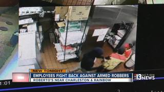 Employees fight back against armed robbers