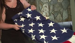 Las Vegas woman tries to find owner of flag