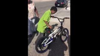 Las Vegas police officer buys boy a new bike