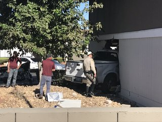 Child hurt after truck crashes into living room
