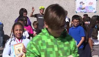 Students get special gift delivered by bicycle