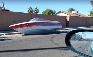 Boat, trash turn neighborhood into eyesore