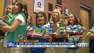 Girl Scouts deliver cards, cookies to cops