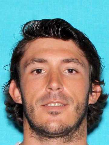 Henderson police looking for dangerous escapee