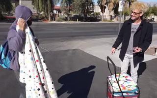 Murray SawChuck gives blankets to homeless man