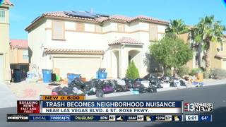 Massive trash pile sits in driveway for weeks