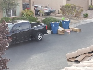 Trash piles cleaned up from front of NW home